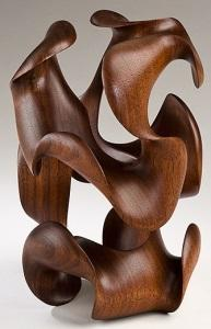 Morph III, finished sculpture in deep walnut by Harry Pollitt