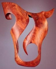 Trapeze, graceful wall sculplture with dramatic negative space.  Sculpted in highly-figured Crotch Burl Walnut by Harry Pollitt.