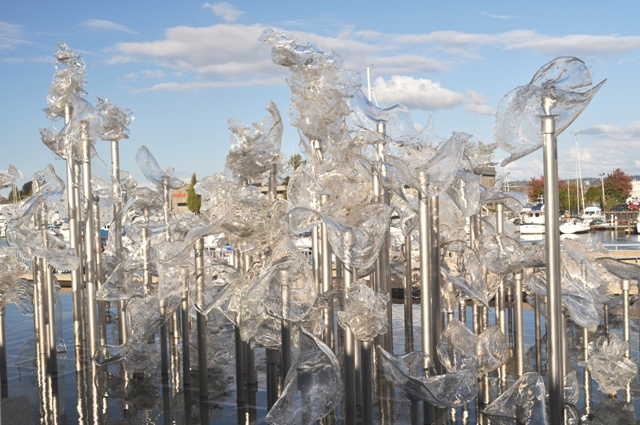Close up of blown, clear glass installation in reflecting pool at entrance to Museum of Glass Tacoma