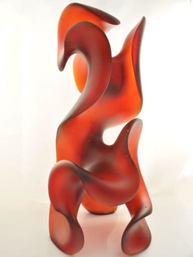 Cast in Dark Orange Red gives this undulating glass sculpture by Harry Pollitt mood and motion.