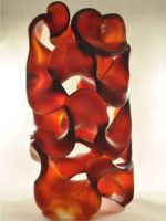 Fluid Dynamics, Harry Pollitt glass sculpture. Large, complex, dynamic curves and negative space in shades of dark orange red.
