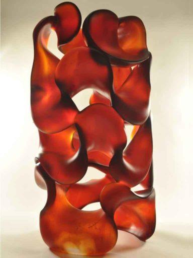 Fluid Dynamics, complex shades of light and dark orange red, glass sculpture by Harry Pollitt