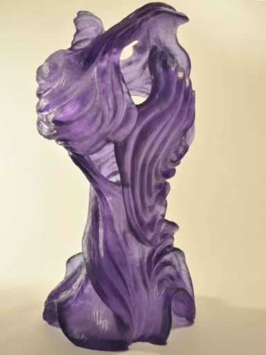 Mariah, image showing Pollitt's sweeping lines and textured surface glass sculpture in Hyacinth-colored cast crystal