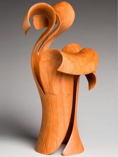 A curl-over in wood sculpted on a curve from Harry Pollitt's Morph Series in wood