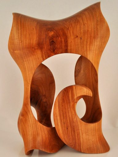 Morph XIV, a curl-over, open-in-center design in wood sculpted from Harry Pollitt's Morph Series