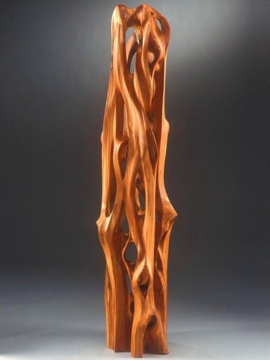 Red cedar wood rescued from a trash heap became this monumental sculpture with numerous penetrations and graceful lines.