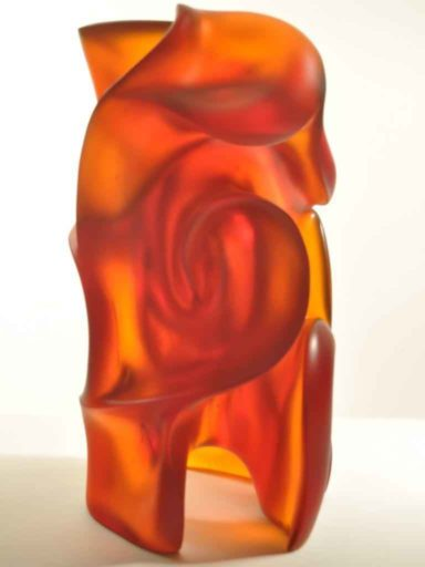 Solid core cast glass sculpture by Harry Pollitt in Yellow Amber reveals deep shadows.