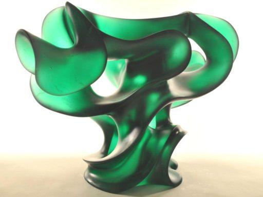 Strong, bold and sensuous, Harry Pollitt's emerald green cast glass sculpture with attitude