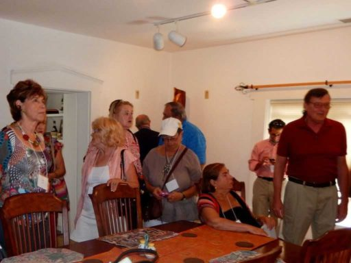 GLANC visitors previewing glass sculptures and wood art in Pollitt's home.