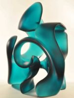 Splash, a jade, green blue glass sculpture with open center and sweeping curves