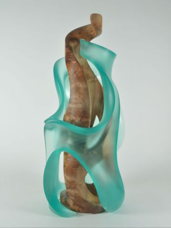 A wood and glass sculpture commission becomes a combination of sweeping lines, negative space and ethereal shadows.