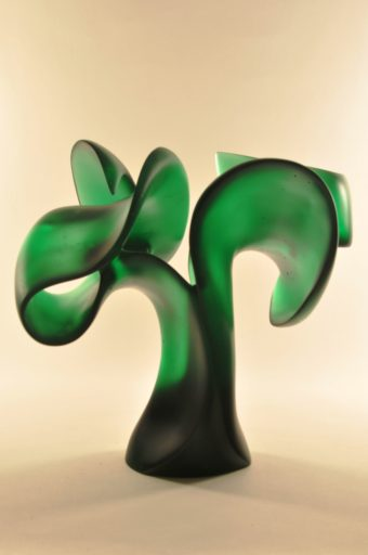 Showing off grace, balance, and deeply edged emerald color. Harry Pollitt's 34th cast glass sculpture.