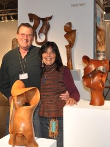 Harry & Gaye Pollitt standing among his wood sculptures at SOFA Chicago 2010