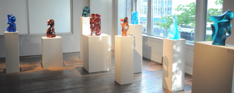 Traver Gallery Pollitt reception displays 7 abstract glass sculptures and 1 wood sculpture