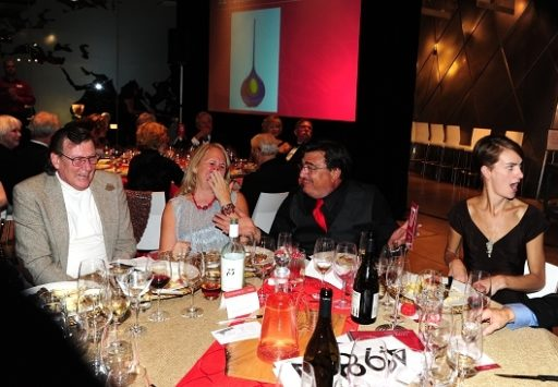 At MOG Red Hot Auction, attendee at this table makes grand purchase of a Lino Tagliapietra blown glass artwork