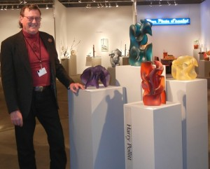 Harry at SOFA Chicago 2013 Opening Night, standing next to his four glass sculptures exhibited by Riley Gallery