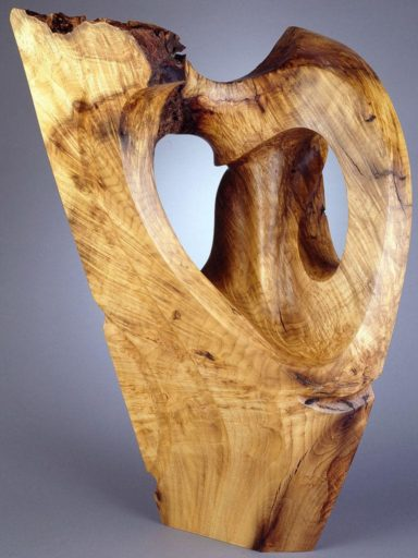 Moab, burl wood sculpture in bay laural, reminds artist Harry Pollitt of sandstone formations in Moab, UT.
