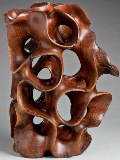 Standing vertically, Harry Pollitt's wood sculpture in Windshake Walnut