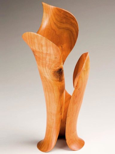 Tunnel-centered cherry wood sculpture, another challenging design execution by Harry Pollitt
