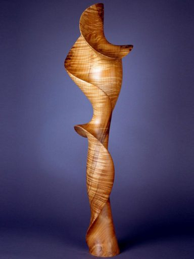 Morph XI, a wood sculpture in highly-figured, light-toned bay laurel by Harry Pollitt.