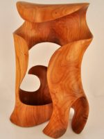 """Curl-over"" wood sculpture in black cherry by Harry Pollitt, Morph XIV, inspired its reflection in glass called Ode to Morph also created by Pollitt"