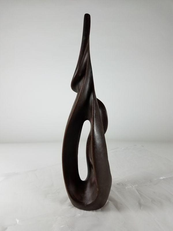 Pollitt new design in its first creative stage - brown wax sculpture