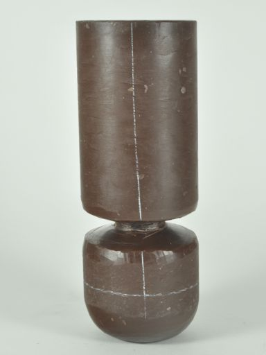 """An 8""""-high cylinder perches on a 1""""-high stem. And together they balance atop a 5""""-high, round-bottomed base."""