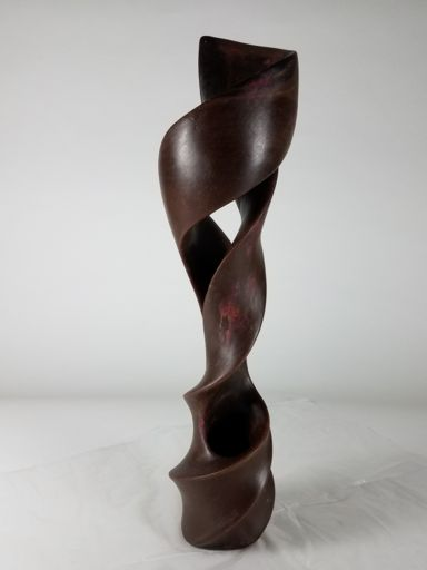 But the final wax reveals a dramatically evolved design.. Multiple, slender twists. Increased negative space. And the artist's pursuit of sculptural grace.
